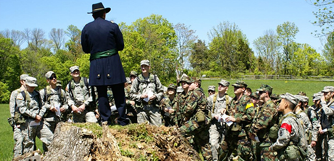 Someone in Civil War garb instructing modern military students- Civil War Medicine Museum Events
