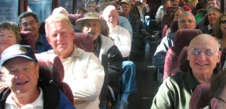 Civil War medical conference attendees on a bus