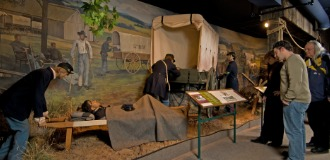 Visitors take in a display about Civil War ambulances at the National Museum of Civil War Medcine