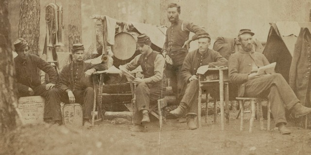 Musicians relaxing in camp. Image courtesy of the LOC
