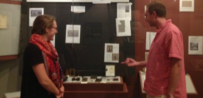 Intern shows interested museum goer new exhibit