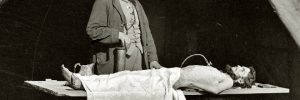 Richard Burr stands over a corpse, ready to embalm- Civil War Medicine Museum