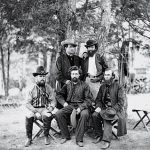 Chaplin William Corby and other members of the Irish Brigade. Harrison's Landing, Va. Group of the Irish Brigade. Photograph from the main eastern theater of war, the Peninsular Campaign, May-August 1862. Sitting from left to right: Captain Clooney, Eighty-eighth New York, Father Dillon, Chaplain of the Sixty-third New York, and Father Corby, Chaplain of the Eighty-eighth New York. Standing from left to right: Visiting priest and Colonel Patrick Kelly, Eighty-eighth New York.