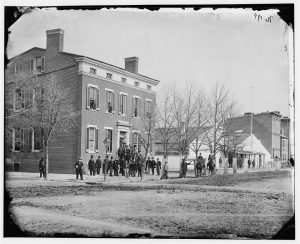 Clerks in front of the Commissary General of Prisons building, F Street at 20th Street, NW, Washington, DC, 1865. Courtesy of the Library of Congress