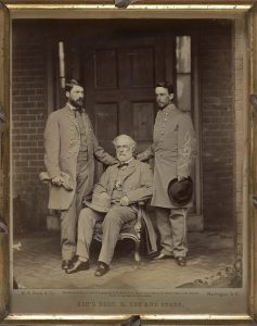 Robert E. Lee (sitting), with son G.W.C. (Custis) Lee on left and Walter Taylor on right, April 1865, Richmond. VA. Courtesy of the Library of Congress