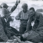 American doctors tending to a soldier. Courtesy of the National Archives