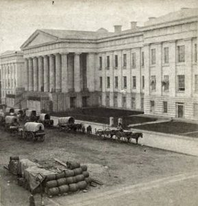 Patent Office, wagons parked on F Street, 1861. Courtesy of the National Portrait Gallery, Smithsonian Institution