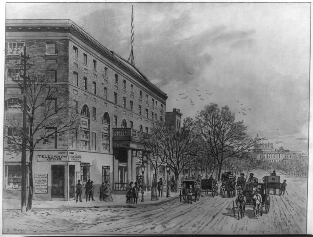 View down Pennsylvania Avenue looking toward the unfinished Capitol building, National Hotel is on the left, 1860. Courtesy of the Library of Congress