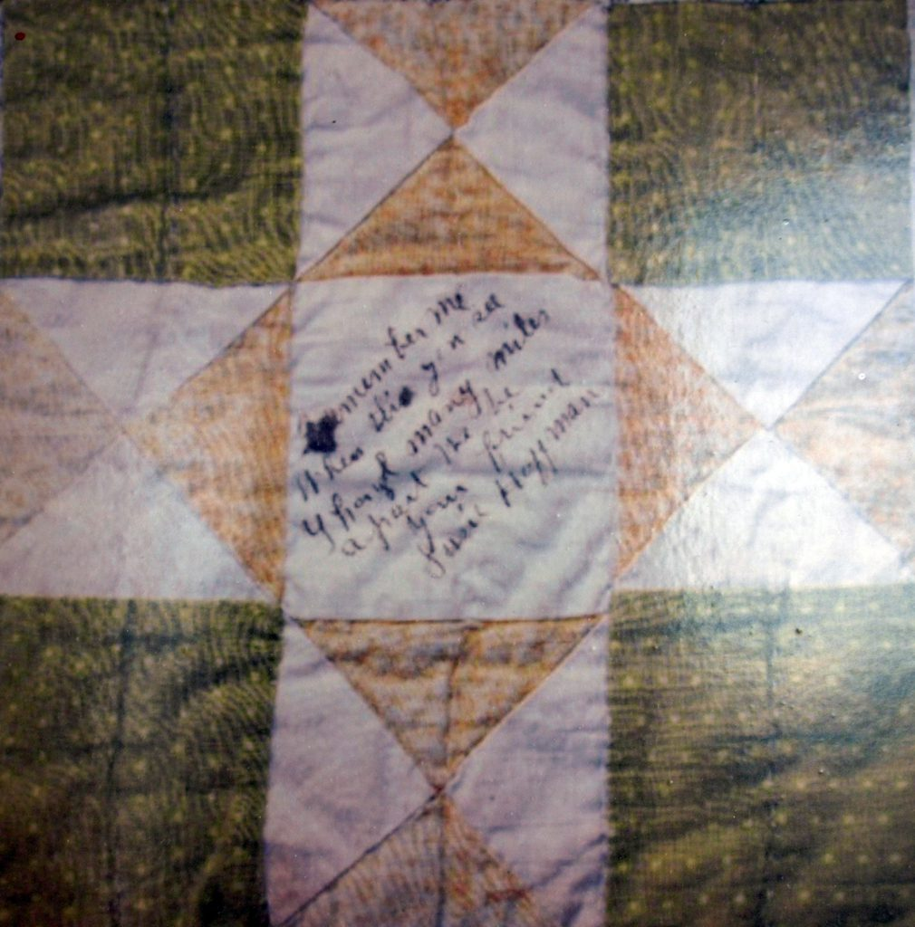 "Quilt Block with inscription: ""Remember me when this you see though many miles apart we be your friend Susie Hoffman"""