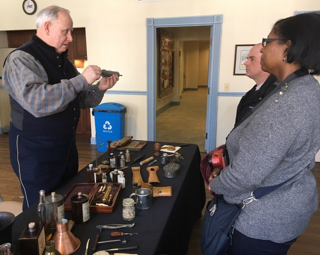 Blue and Gray Hospital Association shows visitors period medical instruments.